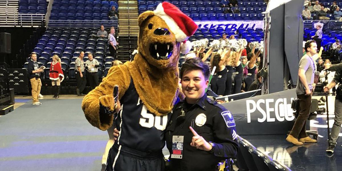 Sgt. Himes with Nittany Lion wearing Santa hat