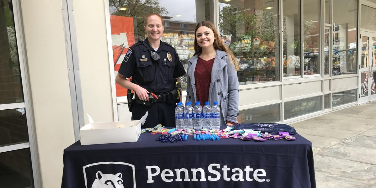 Officer and intern at event table