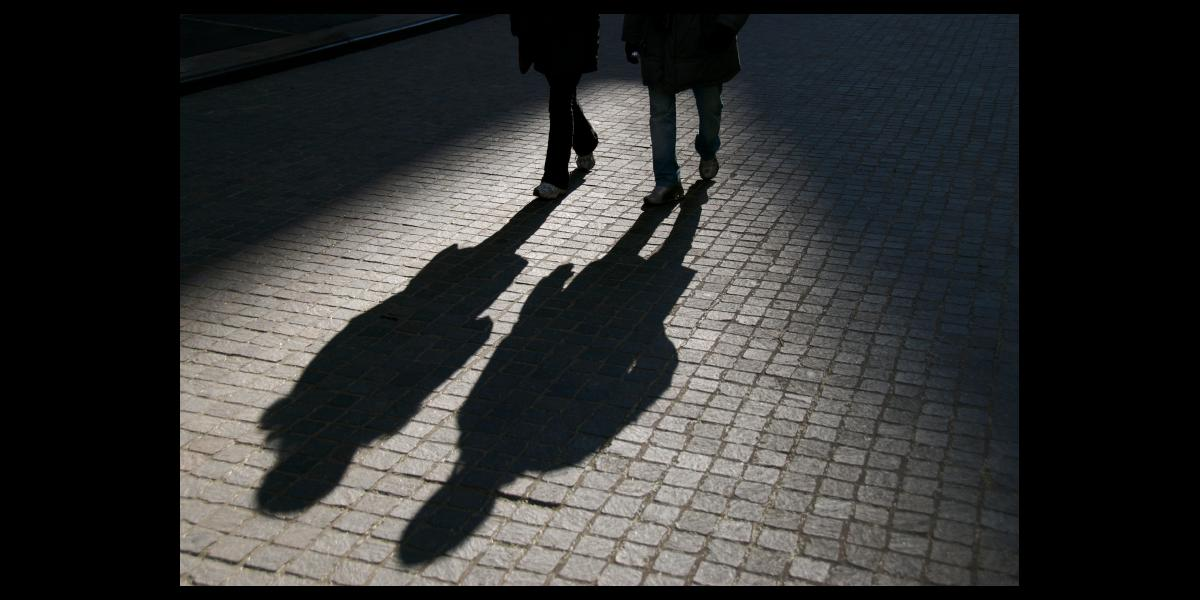 Walking shadows stock photo for safe walk service.