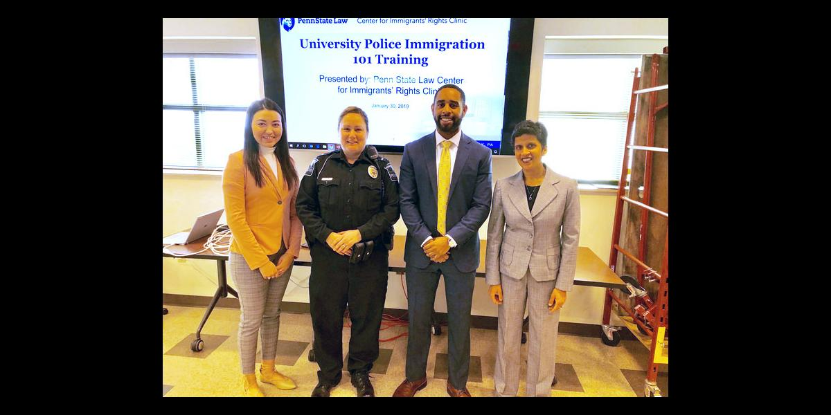 Officer with members of immigration rights clinic