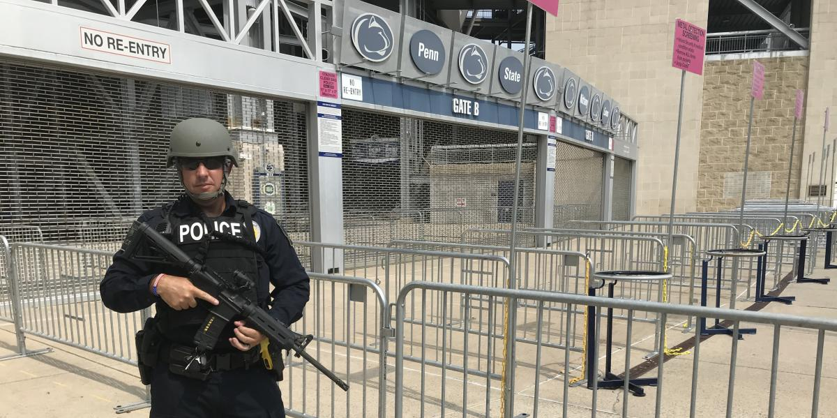 Officer Mike Baker in tactical gear outside Beaver Stadium