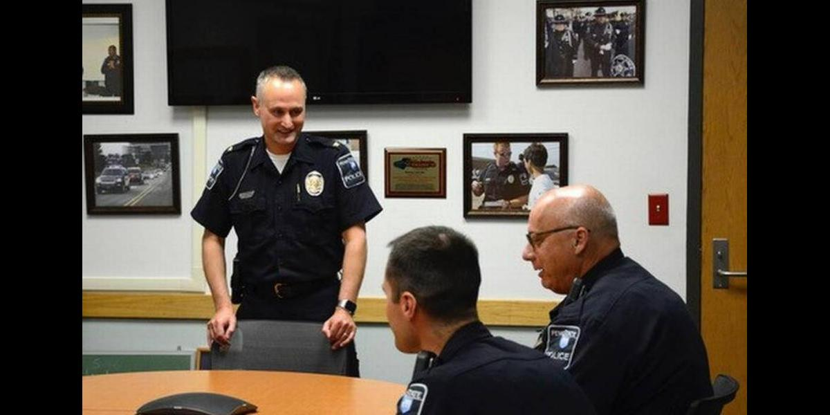 Chief Morris talks with other officers