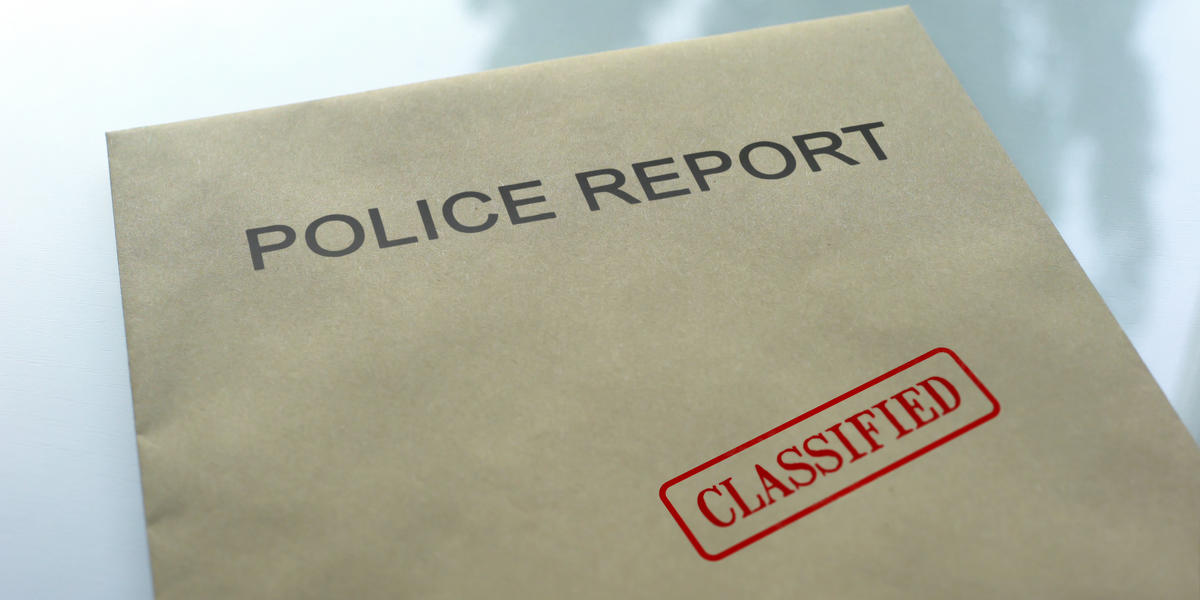 Police report classified, seal stamped on folder with important documents